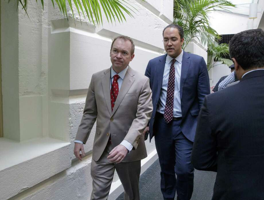 Budget Director Mick Mulvaney (left) and Rep. Will Hurd, R-San Antonio  leave a meeting with President Donald Trump, who came to the Capitol to rally support for the overhaul. Photo: J. Scott Applewhite / Associated Press / AP