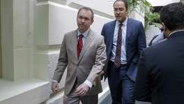 Budget Director Mick Mulvaney (left) and Rep. Will Hurd, R-San Antonio  leave a meeting with President Donald Trump, who came to the Capitol to rally support for the overhaul.