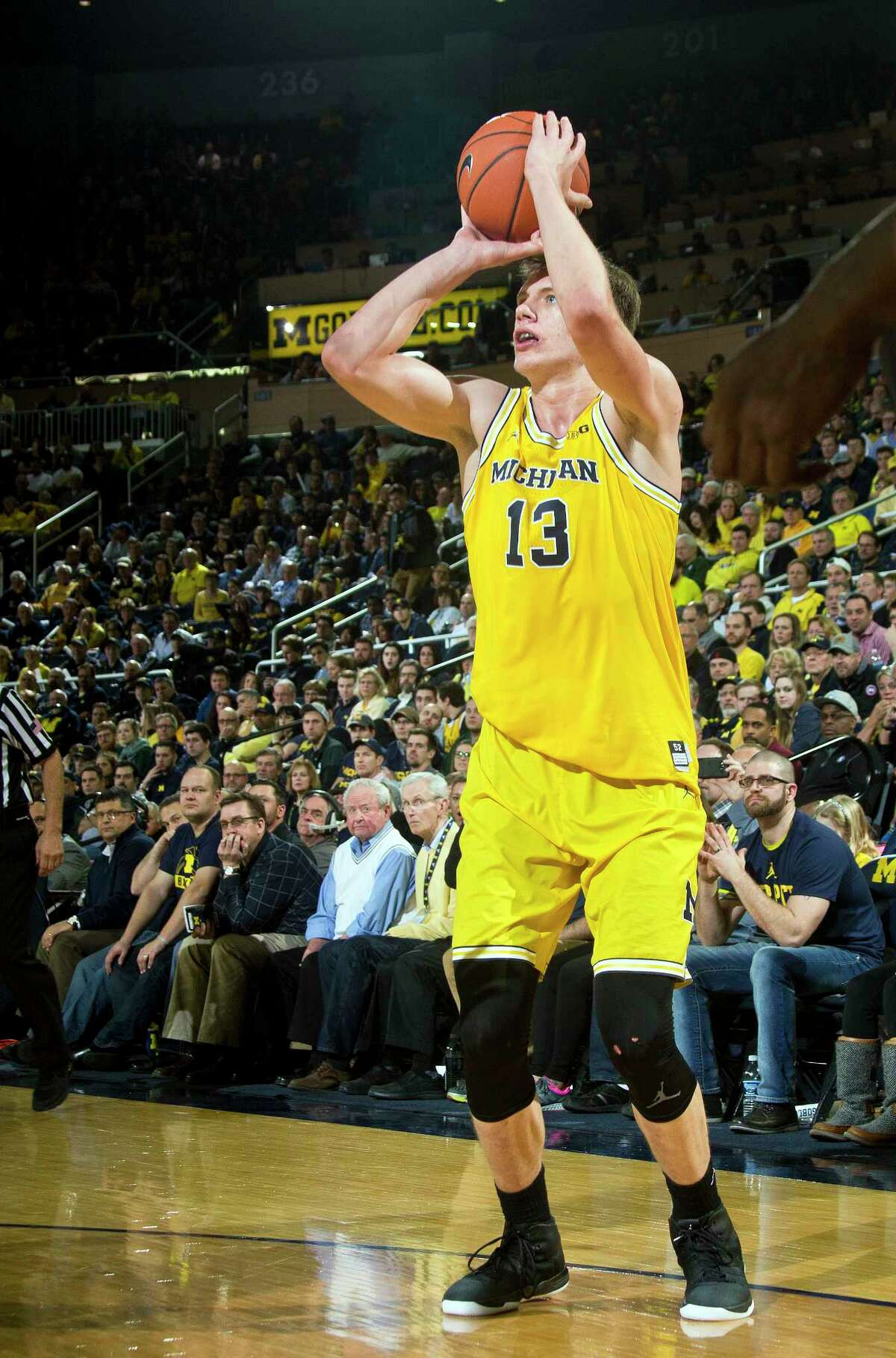 FILE - In this Feb. 7, 2017, file photo, Michigan forward Moritz Wagner (13), of Germany, attempts a three point basket in the second half of an NCAA college basketball game against Michigan State, in Ann Arbor, Mich. The Wolverines have made a school record 340 3s this season, their top six scorers are all capable of making shots from beyond the arc and even 6-foot-11 Moe Wagner and 6-10 D.J. Wilson can make long-range jumpers. (AP Photo/Tony Ding, File) ORG XMIT: NY156