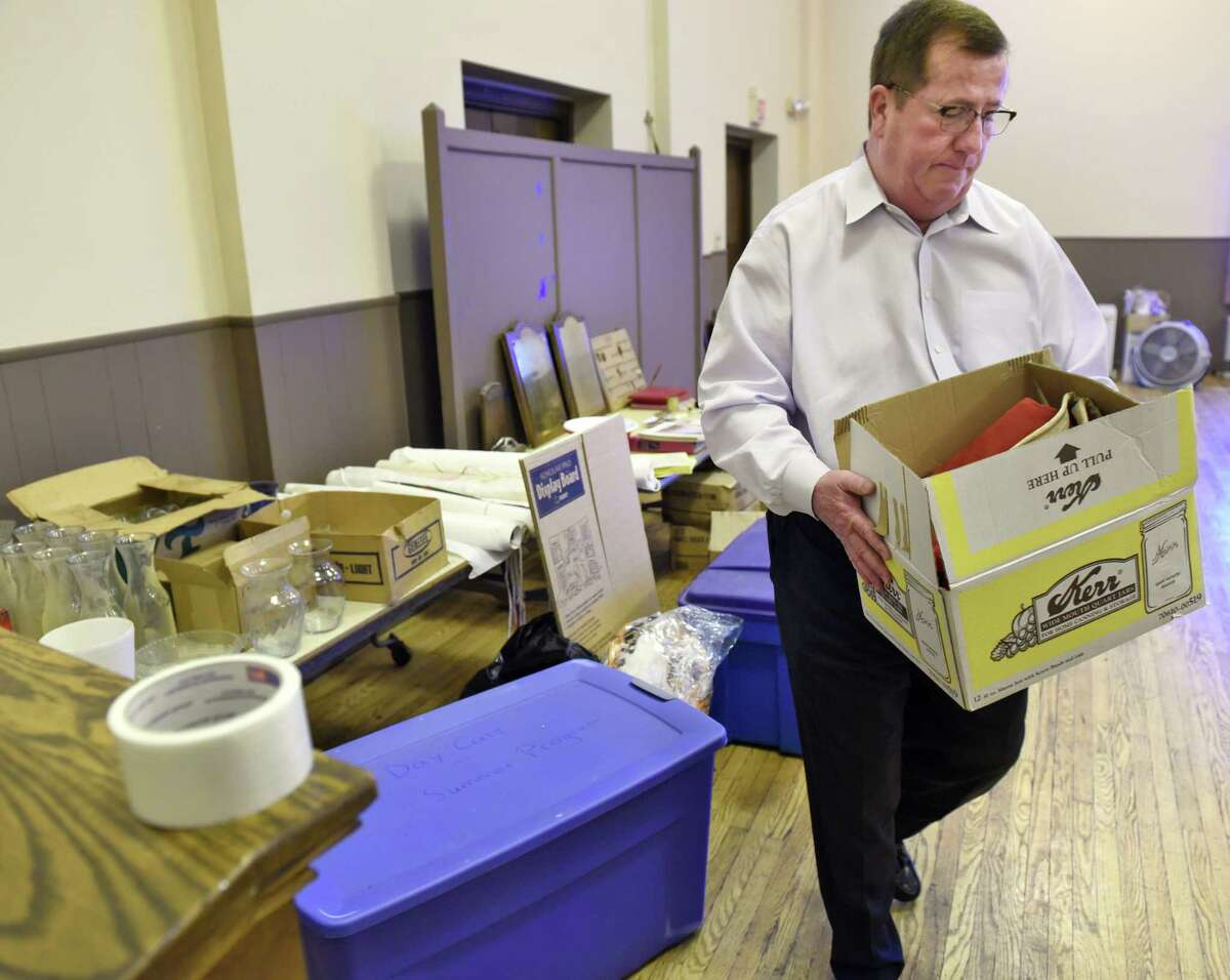 Prince of Peace Lutheran Church treasurer Thomas Cushman prepares for the church's closing Tuesday March 21, 2017 in Troy, NY. (John Carl D'Annibale / Times Union)