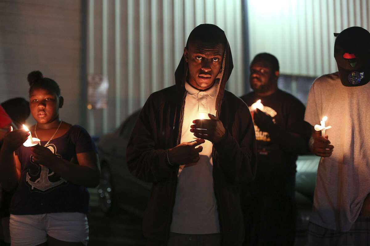 Supporters of Marquise Jones hold a vigil in February on the third anniversary of his death. Jones was shot by an off-duty police officer outside Chacho's and Chalucci's Restaurant. The family's civil wrongful death lawsuit is expected to go to trial Monday.