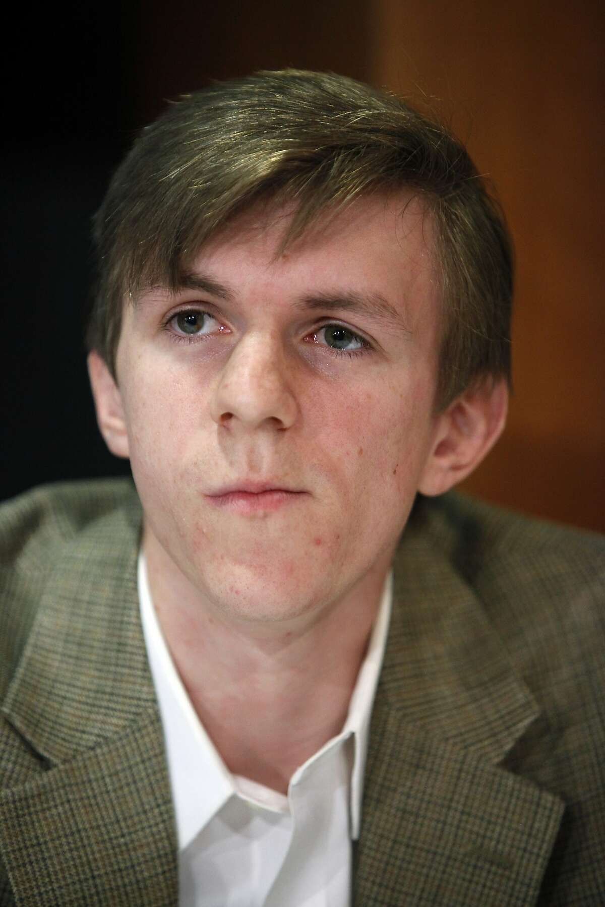 FILE - In a Wednesday, Oct. 21, 2009, file photo, James O'Keefe attends a news conference at the National Press Club in Washington. A National Public Radio executive blasts the tea party movement as