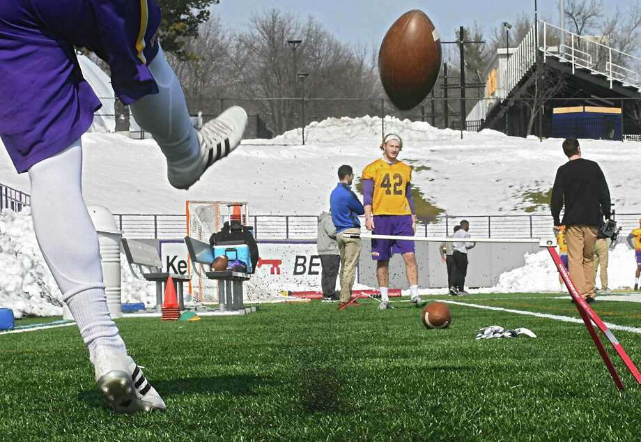 Dylan Burns practices kicking the ball to Ethan Stark as the University at Albany football team holds its first spring football practice on Tuesday, March 21, 2017 in Albany, N.Y. ( Lori Van Buren / Times Union) Photo: Lori Van Buren / 20040016A