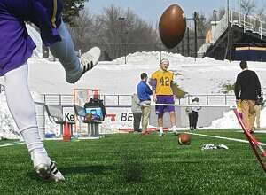 Dylan Burns practices kicking the ball to Ethan Stark as the University at Albany football team holds its first spring football practice on Tuesday, March 21, 2017 in Albany, N.Y. ( Lori Van Buren / Times Union)