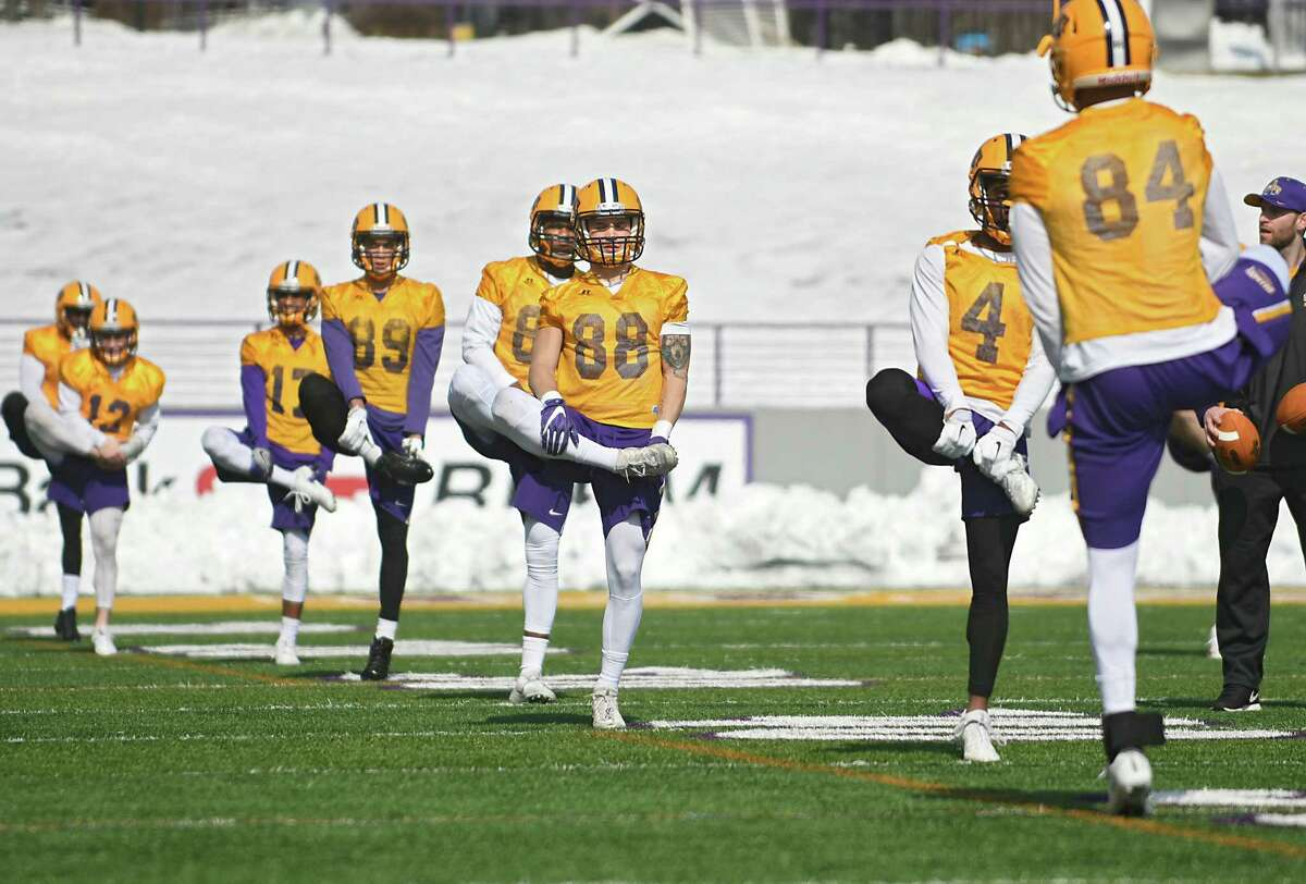 Players stretch as University at Albany football team holds its first spring football practice on Tuesday, March 21, 2017 in Albany, N.Y. ( Lori Van Buren / Times Union)