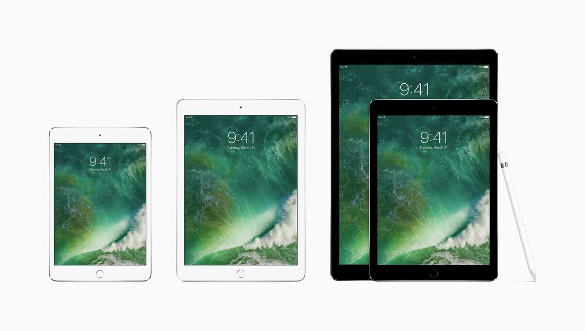 This photo provided by Apple shows the family of iPads, from left, the iPad mini 4, the new iPad, the 9.7-inch iPad Pro and the 12.9-inch one, along with the Apple Pencil.(Apple via AP)