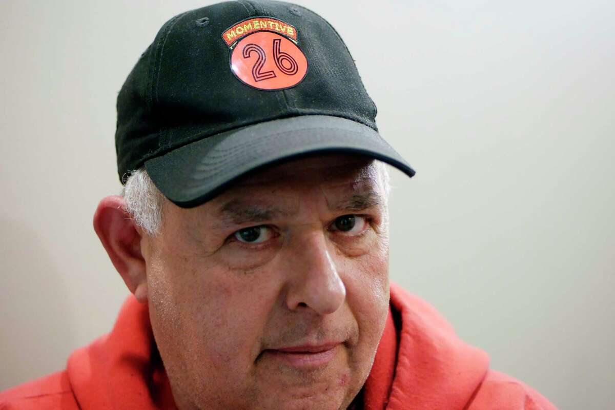 Dominick Patrignani, president of Local 81359 that represents unionized workers at Momentive Performance Materials, shows the red-and-black O26O sticker on his cap that is prompting company managers to threaten suspension for workers who refuse to take it off, seen here on on Tuesday, March 21, 2017, in Colonie, N.Y. The number represents unionized workers who were fired during the strike for alleged misconduct and who remain waiting for investigations to start that could lead to potential rehiring. (Paul Buckowski / Times Union)