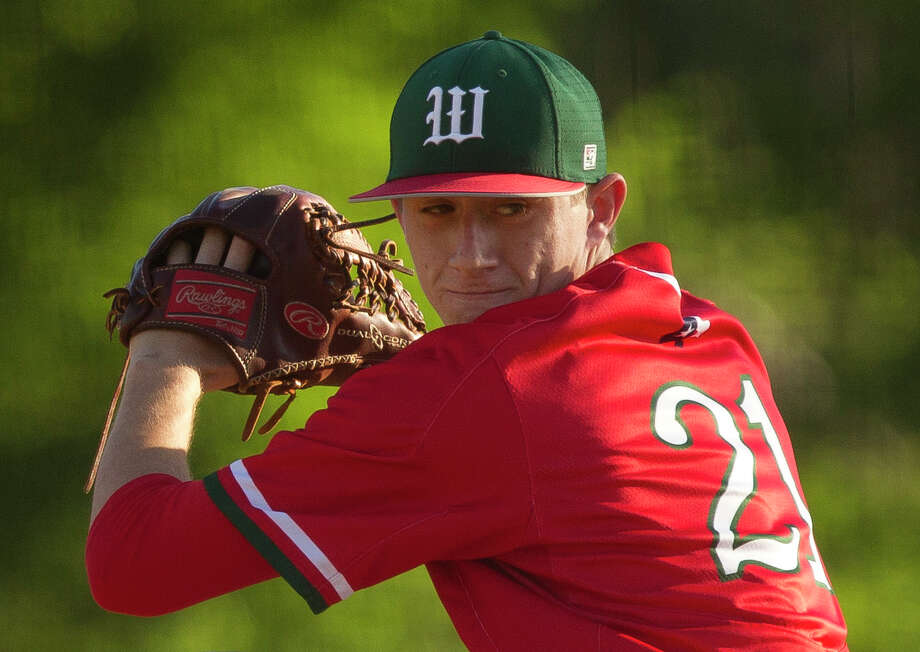 The Woodlands pitcher Devin Fontenot (21) throws during the second inning of a District 12-6A high school baseball game Tuesday, March 21, 2017, in Conroe. Photo: Jason Fochtman, Staff Photographer / © 2017 Houston Chronicle