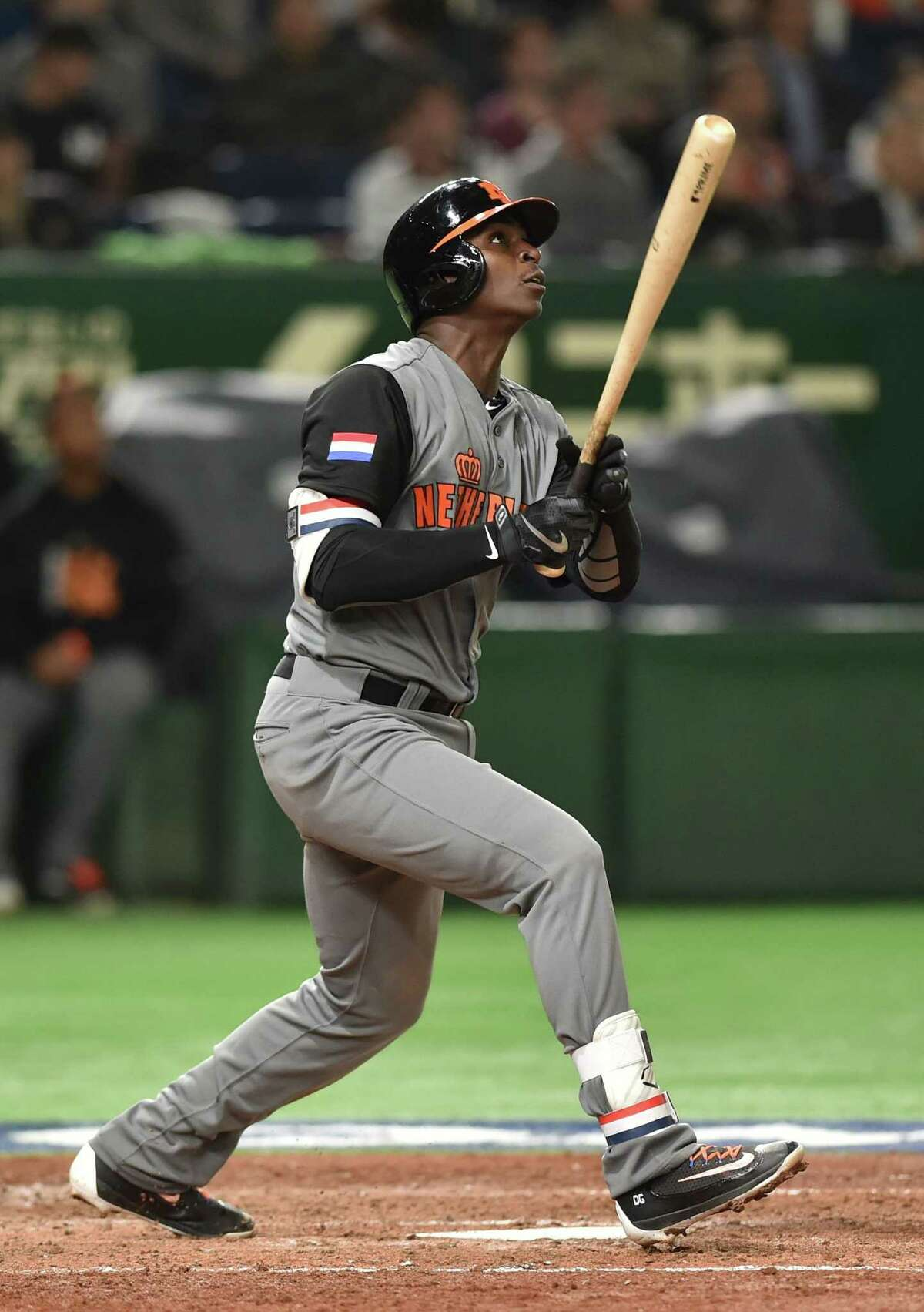 Netherlands' Didi Gregorius follows his three-run homer in the top of the fourth inning during the World Baseball Classic Pool E second round match between Israel and the Netherlands at Tokyo Dome in Tokyo on March 13, 2017. / AFP PHOTO / KAZUHIRO NOGIKAZUHIRO NOGI/AFP/Getty Images