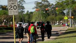 Students walk home from school in the East Beltway 8 area on Tuesday, near where authorities say Carlos Jose Ayala, 35, was believed to have sexually assaulted four students since 2014.  He's been linked to six other attacks.