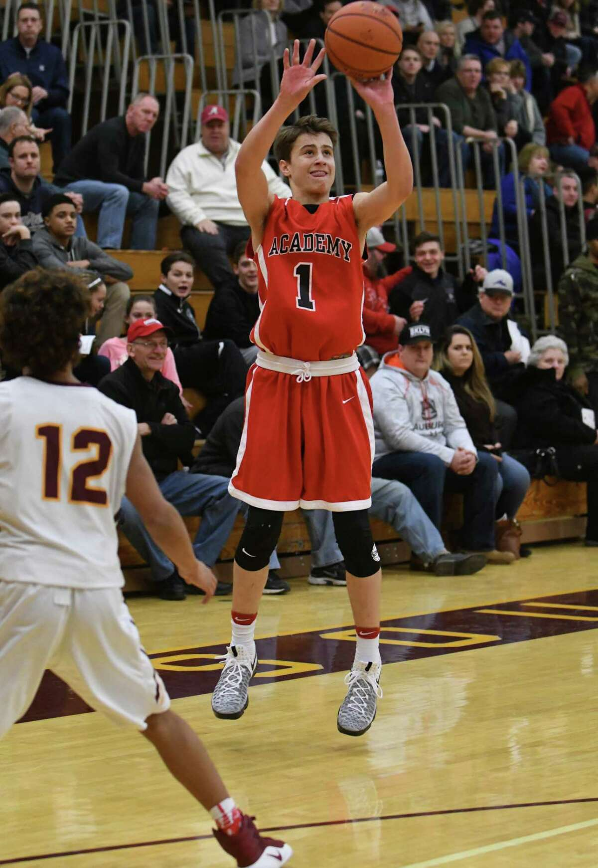 Albany Academy's August Mahoney shoots a three pointer during their high school basketball game against Colonie on Saturday Dec. 31, 2016 in Colonie, N.Y. (Michael P. Farrell/Times Union)