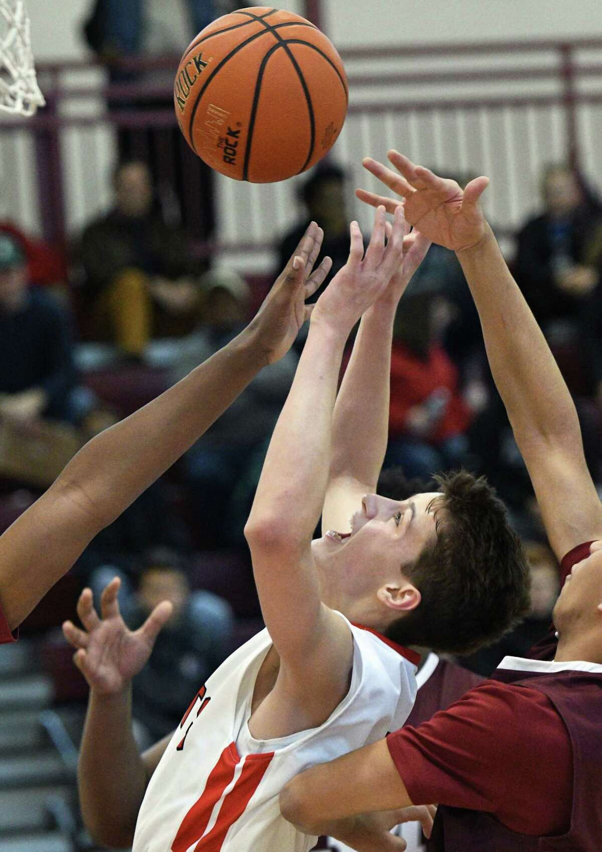 Albany Academy's #1 August Mahoney fights off Lansingburgh defenders for a rebound during Saturday's game at Vliet High Jan. 14, 2017 in Watervliet, NY. (John Carl D'Annibale / Times Union)