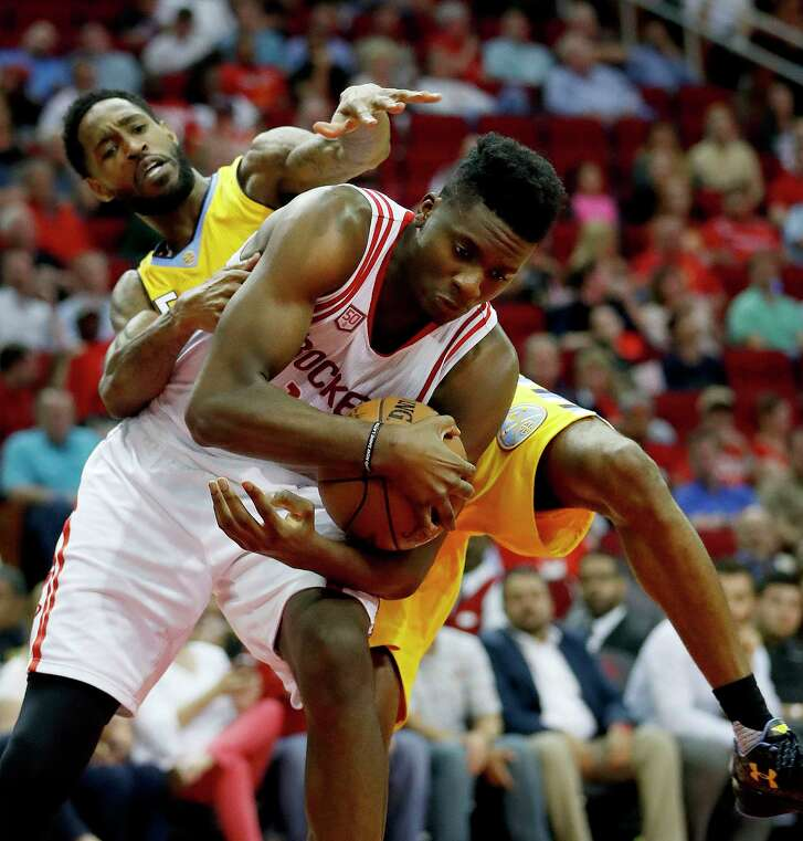 Clint Capela bests the Nuggets' Will Barton for the ball, with rebounding a point of Rockets' emphasis after a plunge in that area since the All-Star break.