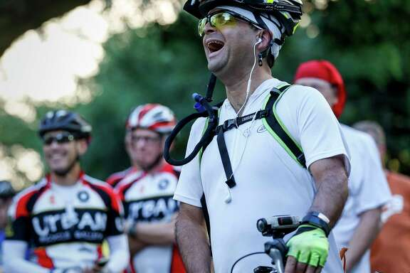 """John Lucci, front in white, laughs during a discussion of the Houston Bike Plan during a rally at City Hall, Tuesday, March 21, 2017, in Houston. Lucci, who said he bikes from Spring Branch to the University of Houston about three times per week, said he supports the plan because of the safety aspects. """"There's been too many ghost bikes,"""" he said."""