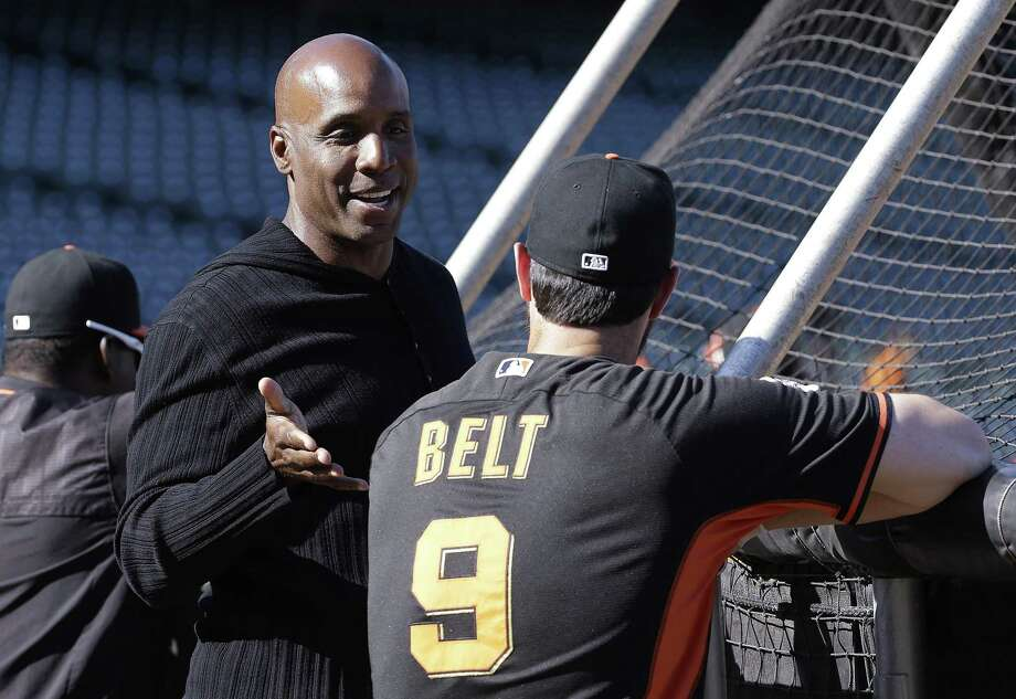 Former baseball player Barry Bonds, left, talks with San Francisco Giants first baseman Brandon Belt during batting practice before a baseball game between the Giants and the Philadelphia Phillies in San Francisco, Friday, July 10, 2015. (AP Photo/Jeff Chiu) Photo: Jeff Chiu / AP / AP