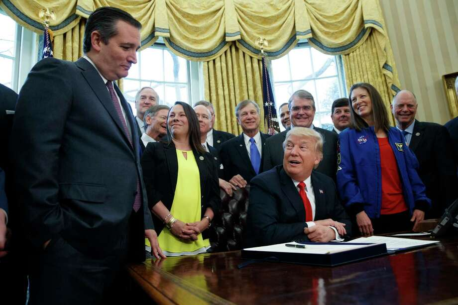 President Donald Trump jokes with Sen, Ted Cruz, R-Texas, during a signing ceremony in the Oval Office of the White House in Washington, Tuesday, March 21, 2017, to increase NASA's budget to $19.5 billion and directs the agency to focus human exploration of deep space and Mars. (AP Photo/Evan Vucci) ORG XMIT: DCEV120 Photo: Evan Vucci / Copyright 2017 The Associated Press. All rights reserved.