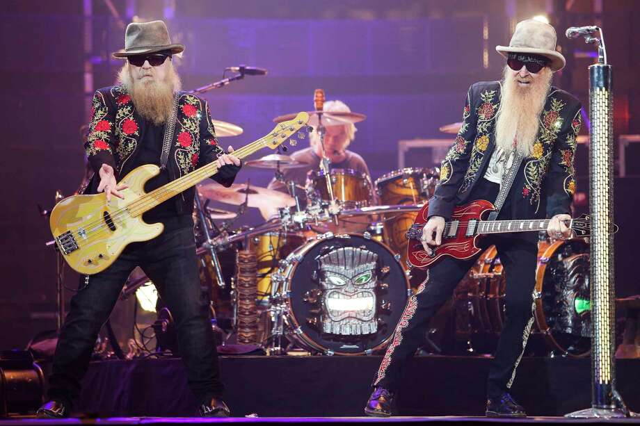 Texas rockers ZZ Top kept the Rodeo Houston crowd energized with wailing guitars, sparkling blazers and gravelly sounds.  Photo: Michael Ciaglo, Staff / Michael Ciaglo
