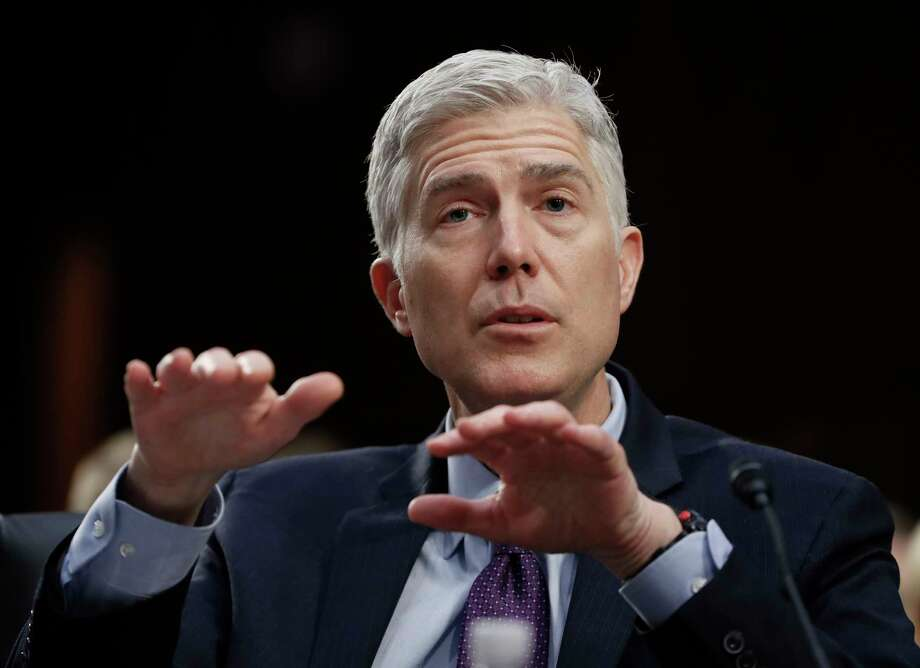 Supreme Court Justice nominee Neil Gorsuch gestures as he testifies on Capitol Hill in Washington, Tuesday, March 21, 2017, at his confirmation hearing before the Senate Judiciary Committee. (AP Photo/Pablo Martinez Monsivais) ORG XMIT: DCPM113 Photo: Pablo Martinez Monsivais / Copyright 2017 The Associated Press. All rights reserved.