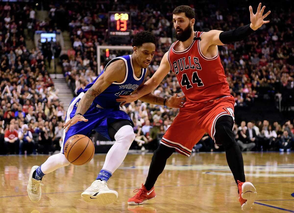 Toronto Raptors guard DeMar DeRozan (10) drives past Chicago Bulls forward Nikola Mirotic (44) during the second half of an NBA basketball game in Toronto, Tuesday, March 21, 2017. (Frank Gunn/The Canadian Press via AP) ORG XMIT: FNG525