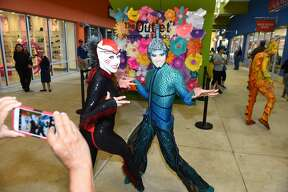 Characters from Cirque Du Soleil OVO interact with shoppers at the Outlet Shoppes of Laredo on Tuesday, March 21, 2017.