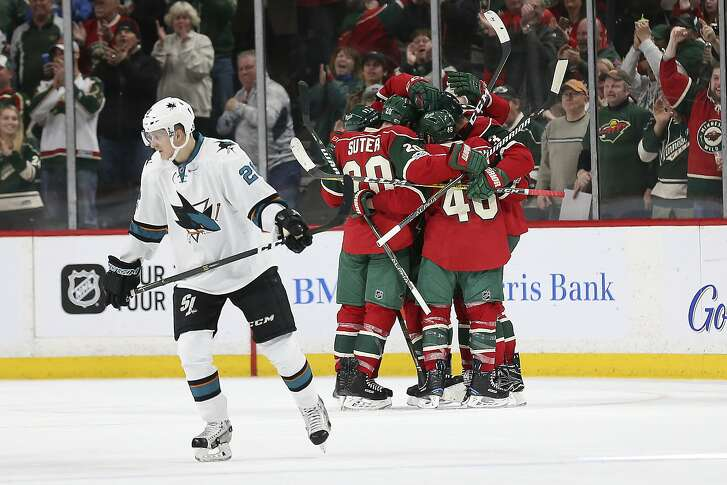 Minnesota Wild players including Ryan Suter (20) and Jared Spurgeon (46) celebrate after scoring a goal against San Jose Sharks' in the second period of an NHL hockey game Tuesday, March 21, 2017, in St. Paul, Minn. (AP Photo/Stacy Bengs)