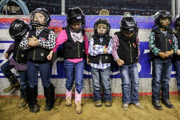 Kids line up as they prepare to compete in the mutton bustin' event during round three of Super Series V at the Houston Livestock Show and Rodeo Tuesday, March 21, 2017 in Houston.
