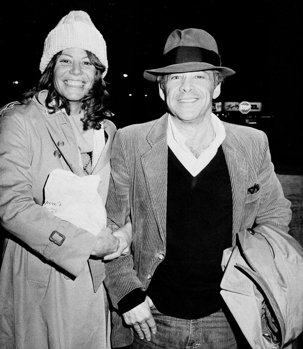 """FILE - In this Nov. 28, 1980 file photo, Chuck Barris, host of the television's """"Gong Show,"""" and Robin Altman leave the Pierre Hotel in New York. Game show impresario Barris has died at 87. Barris, the madcap producer of """"The Gong Show"""" and """"The Dating Game,"""" died of natural causes Tuesday afternoon, March 21, 2017, at his home in Palisades, New York. (AP Photo/Sands, File) ORG XMIT: CAET854"""