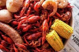 Traditional Cajun crawfish boil is offered at Ragin' Cajun restaurants.