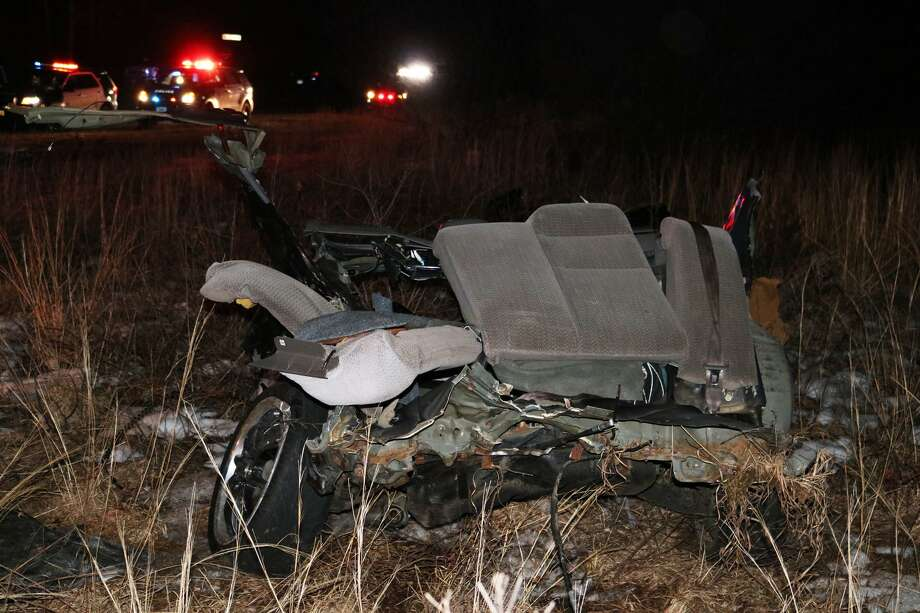 The rear half of a 2000 Honda Civic rests on the side of Route 25 Tuesday night after the driver crashed while allegedly evading a traffic stop, according to police. Newtown, Conn, Mar. 21, 2017 Photo: Contributed Photo / Botsford Fire Rescue / Contributed Photo / Connecticut Post