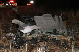 The rear half of a 2000 Honda Civic rests on the side of Route 25 Tuesday night after the driver crashed while allegedly evading a traffic stop, according to police. Newtown, Conn, Mar. 21, 2017