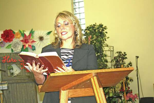Tammy Cross of Grand Rapids addresses a conference Saturday at Faith Gospel Tabernacle in Bad Axe.