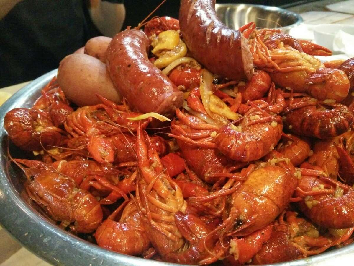 At Cajun Kitchen, market priced crawfish come in spice levels that range from mild, medium, and spicy to extra spicy, suicide and cray cray.
