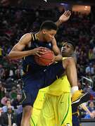 LAS VEGAS, NV - MARCH 10:  Ivan Rabb #1 of the California Golden Bears grabs a rebound against Chris Boucher #25 of the Oregon Ducks during a semifinal game of the Pac-12 Basketball Tournament at T-Mobile Arena on March 10, 2017 in Las Vegas, Nevada. Oregon won 73-65.  (Photo by Ethan Miller/Getty Images)