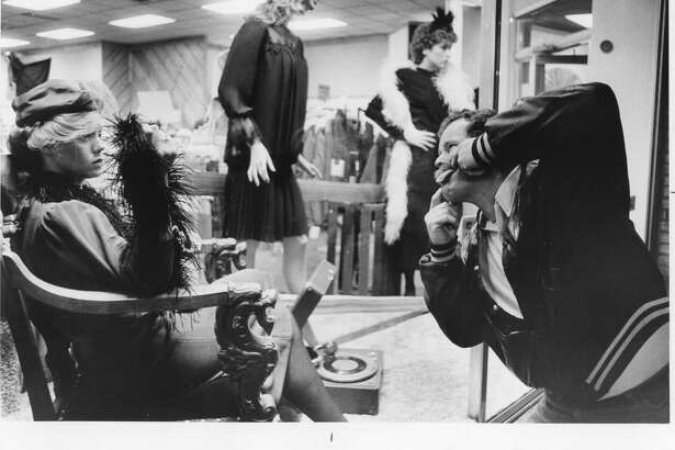 Jerry Klein, tries to break the composure of Northwood sophomore Michele Austerman of Sturgis as she modeled in Sam's Brothers. He didn't. October 1984