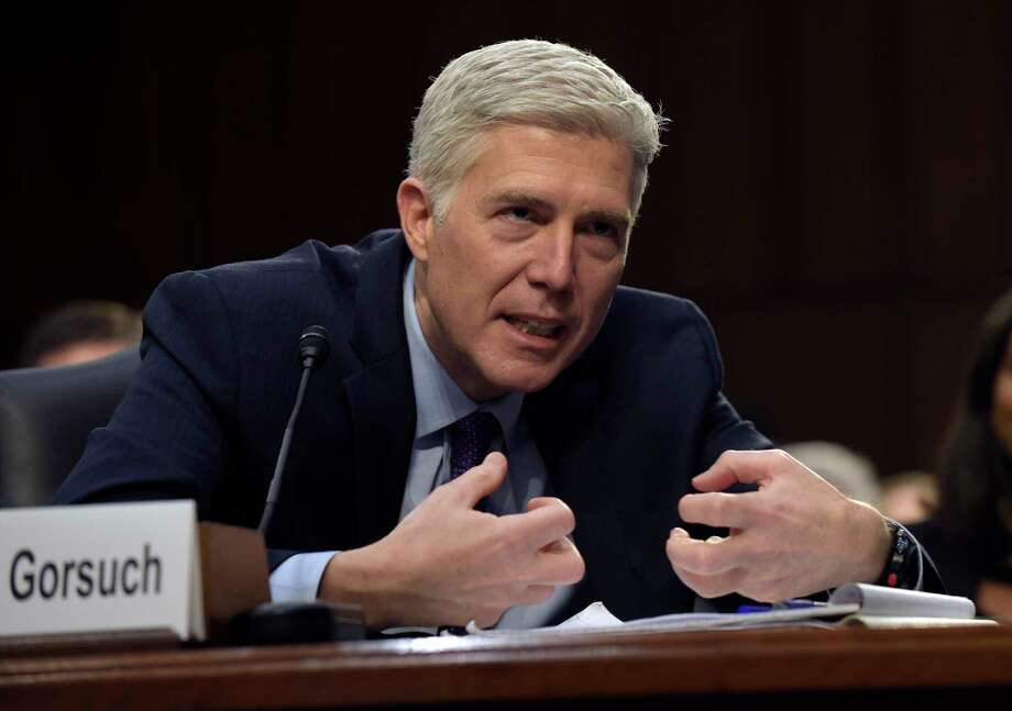 Supreme Court Justice nominee Neil Gorsuch testifies at his confirmation hearing Tuesday.Keep going to see more images of mutton busting at the Houston Rodeo.  Photo: Susan Walsh, Associated Press / Copyright 2017 The Associated Press. All rights reserved.