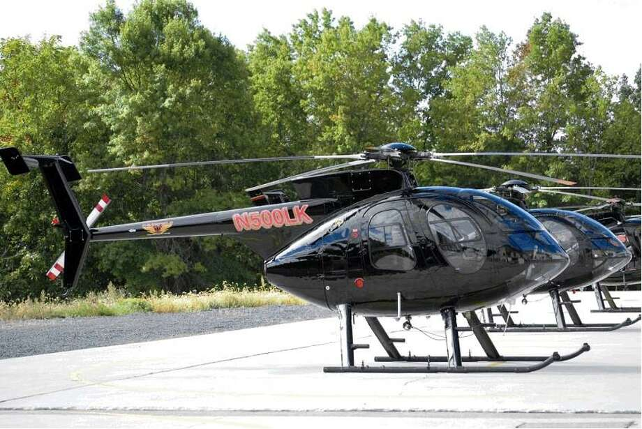 These are the helicopters that will be used by Eversource in the area of Darien, CT, starting Sept. 21. Photo from the Darien Police Department. Photo: Contributed Photo / Contributed Photo / Darien News