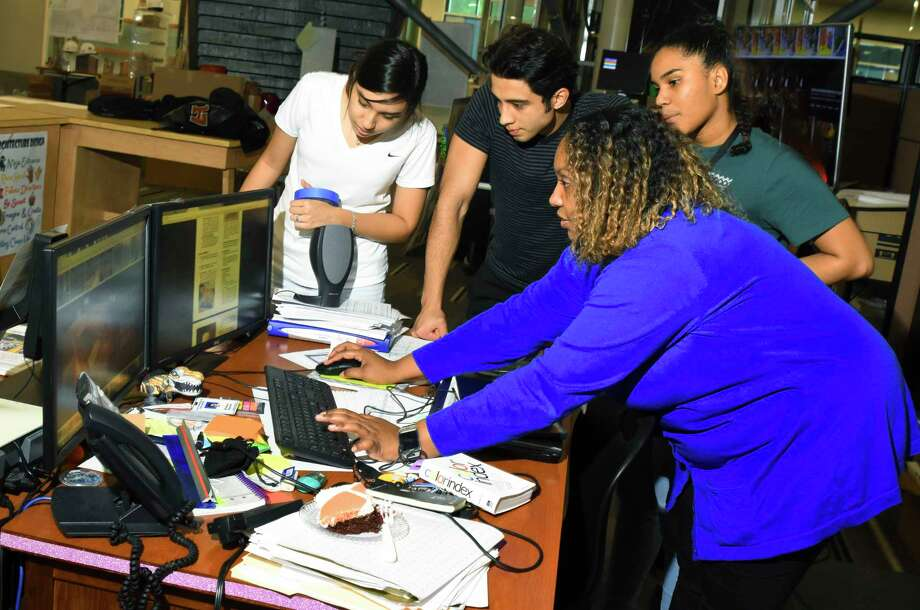 Students at Wunsche Sr. High School are working to collect 1,000 canned goods for a skills competition — and a service project. A team of 10 students will compete against a dozen other schools in a Skills USA CANstruction competition event in Corpus Christi in April. Last year, the team from Wunsche won first place. Architecture teacher Tiara Woods works with students to prepare for the event. Photo: Tony Gaines, Photographer