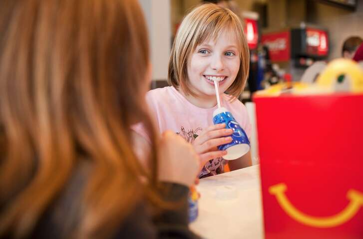 Children enjoying breakfast at McDonald's.