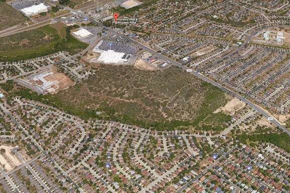 Santikos Enterprises sold 81 acres next to an H-E-B Plus (white building toward the upper center of this photo) on Potranco Road earlier this month.