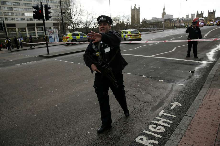 """Police secure the area close to the Houses of Parliament in London, Wednesday, March 22, 2017. The leader of Britain's House of Commons says a man has been shot by police at Parliament. David Liddington also said there were """"reports of further violent incidents in the vicinity."""" London's police said officers had been called to a firearms incident on Westminster Bridge, near the parliament. Britain's MI5 says it is too early to say if the incident is terror-related. (AP Photo/Matt Dunham) Photo: Matt Dunham, Associated Press"""