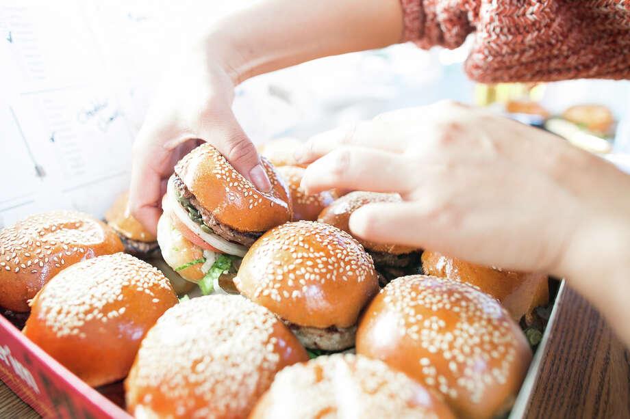 Burgerim, a mini-burger franchise, has opened at 9945 Barker Cypress Road, at the Boardwalk at Towne Lake in Cypress. Photo: Burgerim
