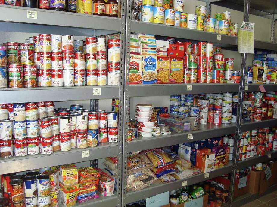 Food drives are conducted to keep the South End Community Center pantry well stocked. Photo: Carol Dumatrait / Carol Dumatrait / Carol Dumatrait