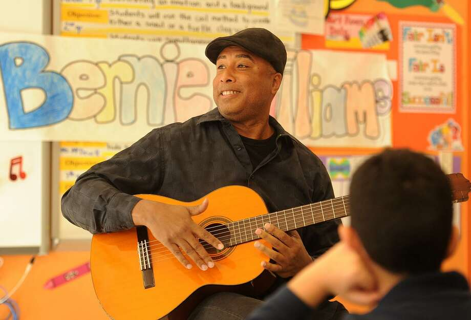Former New York Yankee baseball player and professional musician Bernie Williams entertains children at Geraldine Johnson School as part of Art Counts Day in Bridgeport, Conn. on Wednesday, March 22, 2017. Photo: Brian A. Pounds / Hearst Connecticut Media / Connecticut Post