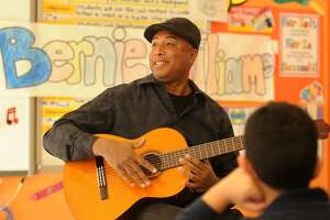 Former New York Yankee baseball player and professional musician Bernie Williams entertains children at Geraldine Johnson School as part of Art Counts Day in Bridgeport, Conn. on Wednesday, March 22, 2017.