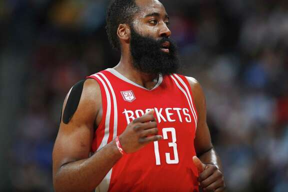 Houston Rockets guard James Harden runs down court in the second half against the Nuggets on March 18, 2017, in Denver. The Rockets won 109-105.