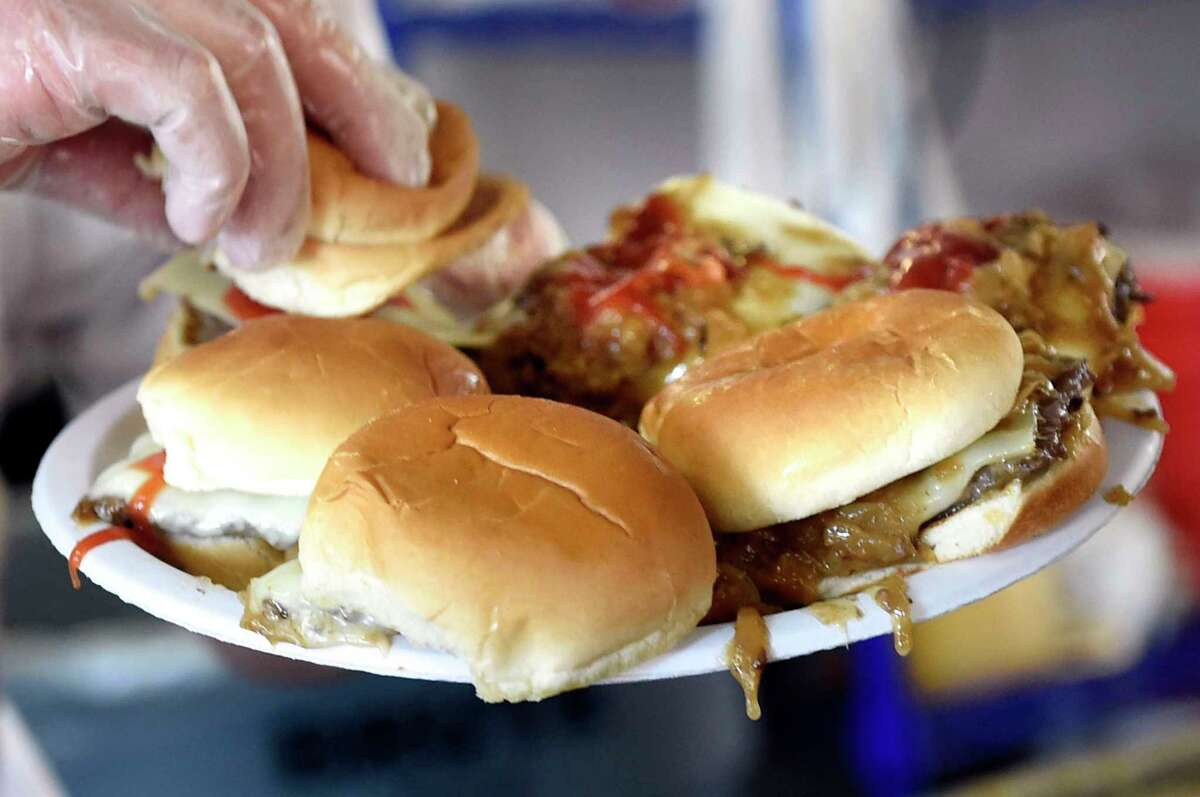 Employee Dave Allen puts together sliders on opening day on Wednesday, March 9, 2016, at Jack's Drive In in Wynantskill, N.Y. (Cindy Schultz / Times Union)