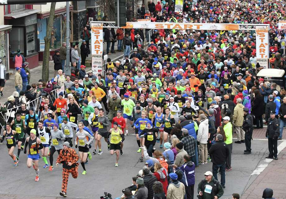 Runners break from the start during the 5k event during the 2016 Troy Turkey Trot on Thursday Nov. 24, 2016 in Troy, N.Y.  (Michael P. Farrell/Times Union) Photo: Michael P. Farrell / 20038852A