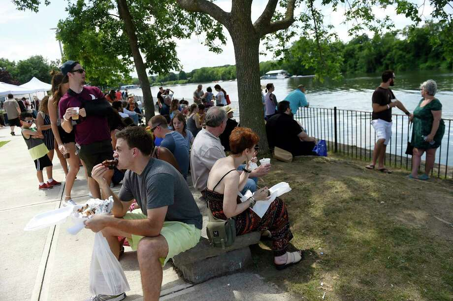 BBQ fans try the different food offerings during the 9th Annual Troy Pig Out on Saturday, July 16, 2016, at Riverfront Park in Troy, N.Y. (Cindy Schultz / Times Union) Photo: Cindy Schultz / Albany Times Union