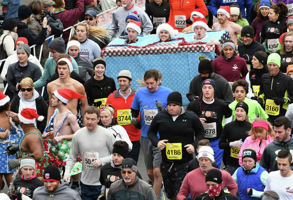 Runners break from the start during the 5k event during the 2016 Troy Turkey Trot on Thursday Nov. 24, 2016 in Troy, N.Y. (Michael P. Farrell/Times Union)