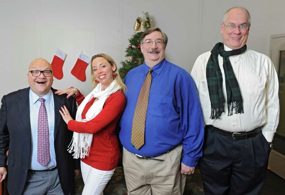 From left, Peter Delocis, Heather Jakeman, Norm Eick and Michael Burns of The Mop & Bucket improv company pose for a photo shoot on how not to take a holiday family photo at the Times Union on Monday, Dec. 1, 2014 in Colonie, N.Y. (Lori Van Buren / Times Union)